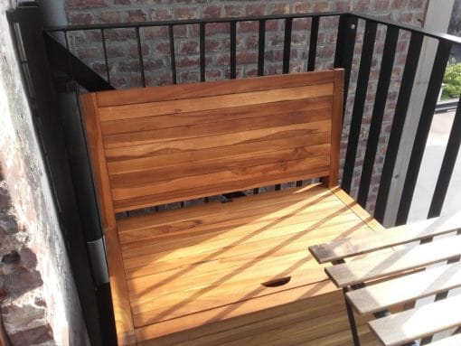 This balcony sofa has been treated with teak oil