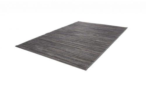 Grauer Balkonteppich mit gemischtem Druck. Sehr gut geeignet für den Außeneinsatz.