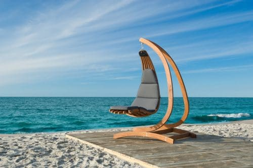 Lounge hanging chair Wave with Dralon cushion at dream location
